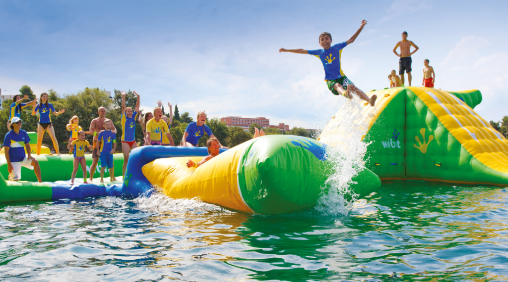 Families Enjoying WIBIT Water Park in Santa Rosa, New Mexico